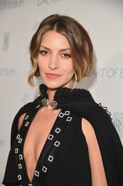 Dawn Olivieri pinned her hair up into a romantic faux bob for the Art of Elysium Heaven Gala.