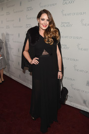 Candice Huffine donned a black gown with a lace cutout and a sheer skirt for the Art of Elysium Heaven Gala.