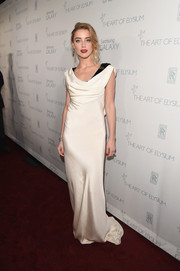 Amber Heard was an Old Hollywood goddess at the Art of Elysium Heaven Gala in a vintage Dior cowl-neck gown in white silk over black velvet.