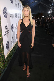 Ali Larter opted for a flirty black cutout dress with ruffle embellishments when she attended the Art of Elysium Heaven Gala.