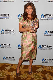 Teri Hatcher finished off her floral ensemble at the Arthritis Foundation soiree with brown peep-toe booties.