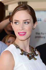 Emily Blunt chose a center-parted pinned updo for her classic look at the Toronto Film Festival.