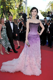 For her umpteenth amazing look at the Cannes Film Festival, Fan donned a purple ombre evening gown with a structured bodice and lushly textured train.