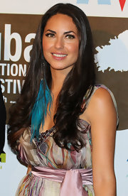 Barbara Mori added a funky touch to her look with a vibrant blue feather earring.