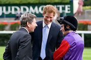 Prince Harry wore a pale blue tie with his classic navy suit at the Ascot Races.