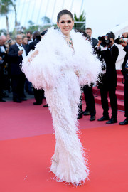 Araya A. Hargate worked a fully feathered jumpsuit by Ashi Studio Couture at the Cannes Film Festival screening of 'Ash is the Purest White.'