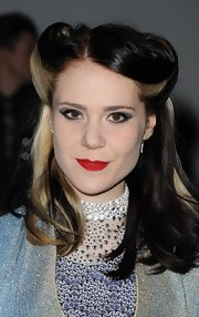 Kate Nash attended the Ashish fall 2012 fashion show wearing her hair in retro-inspired reverse rolls.