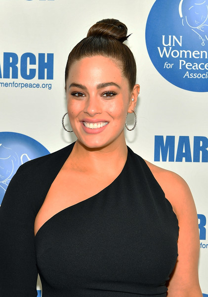 Ashley Graham Hair Knot [hair,shoulder,hairstyle,beauty,electric blue,bun,joint,premiere,smile,dress,ashley graham,model,new york city,international womens day united nations awards luncheon]