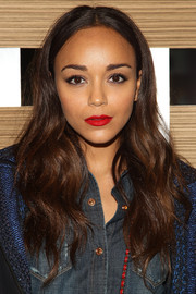 Ashley Madekwe hosted the launch of 7 for All Mankind x Malhia Kent wearing a boho-chic center-parted wavy 'do.