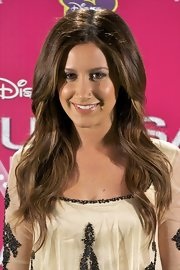 Ashley Tisdale styled her hair in a center part wavy style.