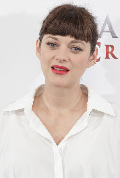 Marion Cotillard worked some seriously blunt bangs at the Madrid photocall for 'Assassin's Creed.'