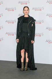 Marion Cotillard toughened up her dress with a distressed black moto jacket by Facetasm.