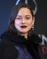Marion Cotillard played up her lips with this sexy berry hue.