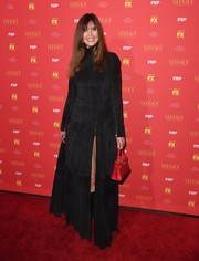 Carol Alt attended the New York screening of 'The Assassination of Gianni Versace: American Crime Story' wearing a high-neck black maxi dress.