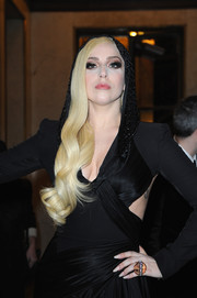 Lady Gaga looked dramatic wearing this statement ring and hooded gown combo at the Atelier Versace fashion show.
