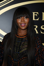 Naomi Campbell sported ultra-long tresses with eye-grazing bangs during the Atelier Versace fashion show.