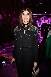 Carine Roitfeld donned a stylish crystal-encrusted tie-neck blouse for the Atelier Versace fashion show.