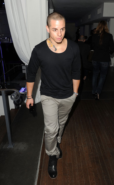 Casper Smart's patent leather lace up boots added some shine to his tonal outfit.