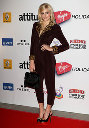 Pixie Lott finished off her red carpet look with a black fur purse.