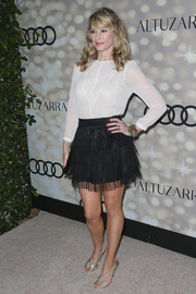 Meredith Monroe played with contrasts at the Emmy kickoff party, pairing a fun black mini skirt with a conservative white blouse.