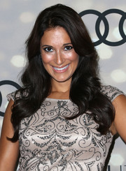 Angelique Cabral left her hair loose with lovely waves when she attended the Emmy kickoff party.