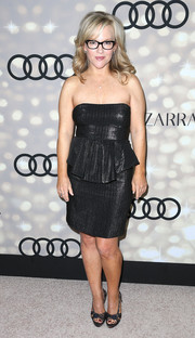 A pair of embellished platform peep-toes finished off Rachael Harris' ensemble.