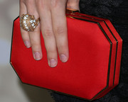 Sarah Hyland accessorized with a stylish geometric red satin clutch when she attended the Emmy kickoff party.