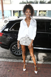 Jourdan Dunn teamed her shirt with a mirror-embellished mini skirt, also by Kaufmanfranco.