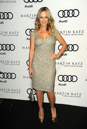 Julie Benz dazzled at the Audi soiree in Hollywood in a silver beaded frock. The starlet topped off her look with gold platform peep-toe pumps.