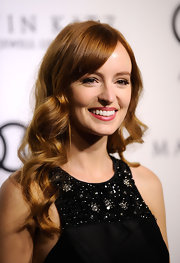 Ahna O'Reilly attended the 2012 Golden Globe Awards celebration wearing long copper curls and side-swept bangs.