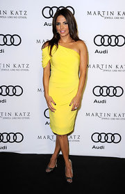 Azita shined in a draped yellow frock at the Audi soiree in Hollywood. She paired the look with metallic peep-toe pumps.