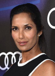 Padma Lakshmi styled her look with a pair of classic diamond studs.