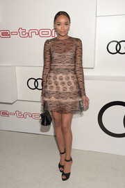 Ashley Madekwe looked ultra feminine in a long-sleeve lace mini dress during Audi's celebration of Emmys week.