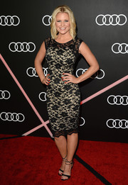 Carrie Keagan finished off her ensemble with a sultry pair of black ankle-wrap sandals.