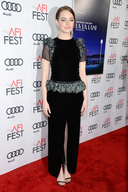 Emma Stone chose a black Armani Prive velvet gown with sheer, short sleeves and ruffled shoulders and hips for the AFI Fest premiere of 'La La Land.'