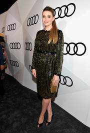 Carly Steel added extra shine with a metallic gold clutch by Nicoli.