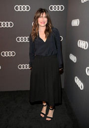 Kathryn Hahn completed her ensemble with black ankle-strap sandals.