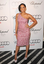 Tia Mowry complemented her pink and white asymmetrical dress with bone suede Brigitt High Platform pumps.