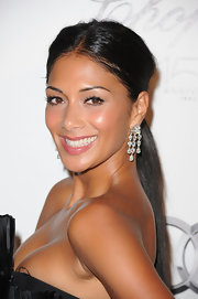 Nicole paired her dangling earrings with a sleek ponytail.