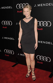 Teri Polo went for a sultry look with black patent wrap around sandals.