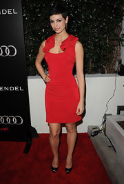 Morena was stunning in a red body-con cocktail dress with a ruffled shoulder detail.
