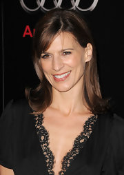 Actress Perrey Reeves styled her brunette locks into a sleek straight style with a slight flip at the ends.