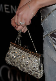 Sara Rue looked elegant carrying a sophisticated beaded evening bag.