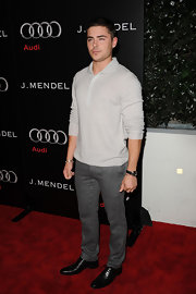 Zac looks fashion forward in a pair of skinny gray textured pants.