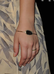 Actress Kaley Cuoco attended Audi and J. Mendel's kick off celebration of Golden Globes Week wearing an 18-karat gold rock candy Polished 2 Pebble bangle in black shell with diamonds.
