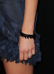 Angela Lindvall paired her navy dress with a spiked bangle bracelet.