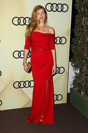 Connie Britton has never looked better! Check out this smoldering crimson dress she wore to kick off Golden Globes week.