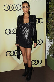 Maggie Q looked was one hot chick in this sequined mini and rocking leather jacket.