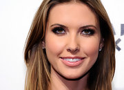 Audrina Patridge looked red carpet ready at Pure Nightclub. She added a glossy touch to her look with peach gloss.