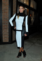 Jessica Szohr wore a pointed-shoulder pad monochromatic black-and-white dress that matched her peep toe heels.